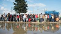 Queues of migrants on the Macedonian-Greece border