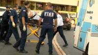 Emergency crew save woman on stretcher