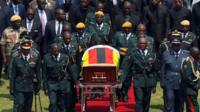 Mugabe coffin brought to the national sports stadium for a state funeral in Harare