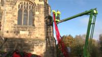 Poppies being fixed to church