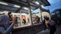 Women vandalise a Metrobus station during a protest in Mexico City