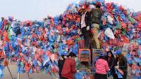 Volunteers make a sculpture out of plastic bags in Kathmandu