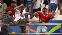 Russian fan kicking an England fan