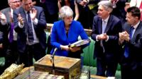 Theresa May looks back on her record at PMQs before she is cheered by colleagues as she leaves the chamber.