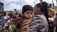 Woman holding child at San Ysidro