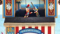A Punch and Judy puppet show on a beach