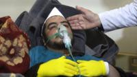 Syrian man in gas mask