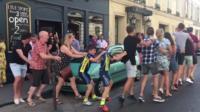 Dancing in the street - Geraint Thomas fans celebrate in Paris