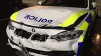 Damage to police car