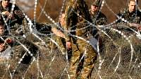 The Slovenian army build the barbed wire barrier on the border between Slovenia and Croatia