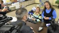 Rowan County Clerk Kim Davis, right, talks with David Moore following her office's refusal to issue marriage licenses at the Rowan County Courthouse