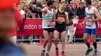 Matthew Rees helping David Wyeth to the finish line