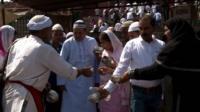 Indian bhishti distributes water