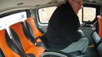 Dave Thompson in a wheelchair accessible taxi