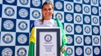 Maya holding award