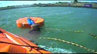 Man clings to mooring buoy in the water