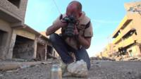 James Bevan of Conflict Armament Research photographs munitions found in Iraq