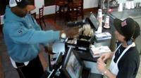 A cashier at Jimmy John's takeaway in Kansas City, Missouri tells the BBC how he kept his astonishing cool when a robber stuck a gun in his face.