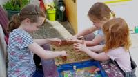 Children play in a sandpit