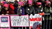 Women wearing pink pussy hats at a march