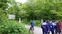 Media members gather near a military drill area in Shikabe town, on the northernmost main island of Hokkaido Friday, 3 June 2016.