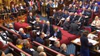 Theresa May looks on in House of Lords debate