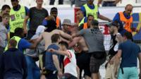 Groups of supporters clash fight at the end of the Euro 2016 group B football match between England and Russia at the Stade Velodrome