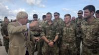 Boris Johnson meets British soldiers in Barbados