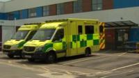 Two ambulances outside a hospital