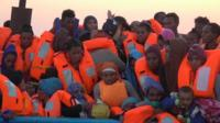 Migrants in life jackets