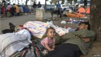A migrant familly sleeps in a park near the main bus and train station in Belgrade
