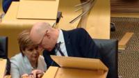 Nicola Sturgeon talks to John Swinney