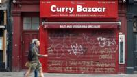 A curry restaurant with its shutter down