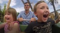 Family enjoy theme park ride