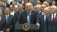 US President Donald Trump and House Republicans celebrated a vote on a healthcare bill at the White House.