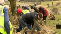 Volunteers helping at flood-damaged farm
