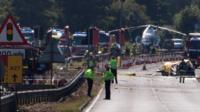 Police and members of the emergency services work at the scene of a plane crash at Shoreham airfair in Shoreham