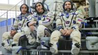 Two Russian cosmonauts and a US astronaut docked at the space station after their rocket took off from Kazakhstan.