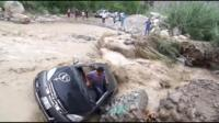 A survivor emerges from a car washed away by flooding in Peru