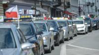 Warsaw taxis crawl along in anti-Uber protest