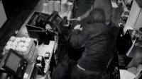 Thieves breaking a cafe till