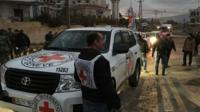 Red Cross working alongside the Syrian Arab Red Crescent (SARC) and the United Nations (UN), shows a convoy containing food, medical items, blankets and other materials being delivered to the town of Madaya