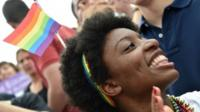 Woman celebrates outside Supreme Court