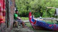 A man sits with his boat