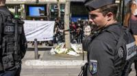 French officers pay tribute to officer killed on the Champs Elysee in Paris, 21 April 2017