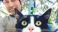 Shaun Sears with a cat he's rescued