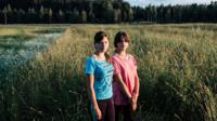 Sisters standing in the fields