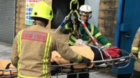 Emergency crews doing bariatric rescue training