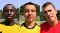 Three young male football players in Germany