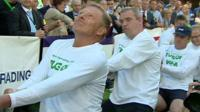 Parliamentary tug of war team with reporter Giles Dilnot